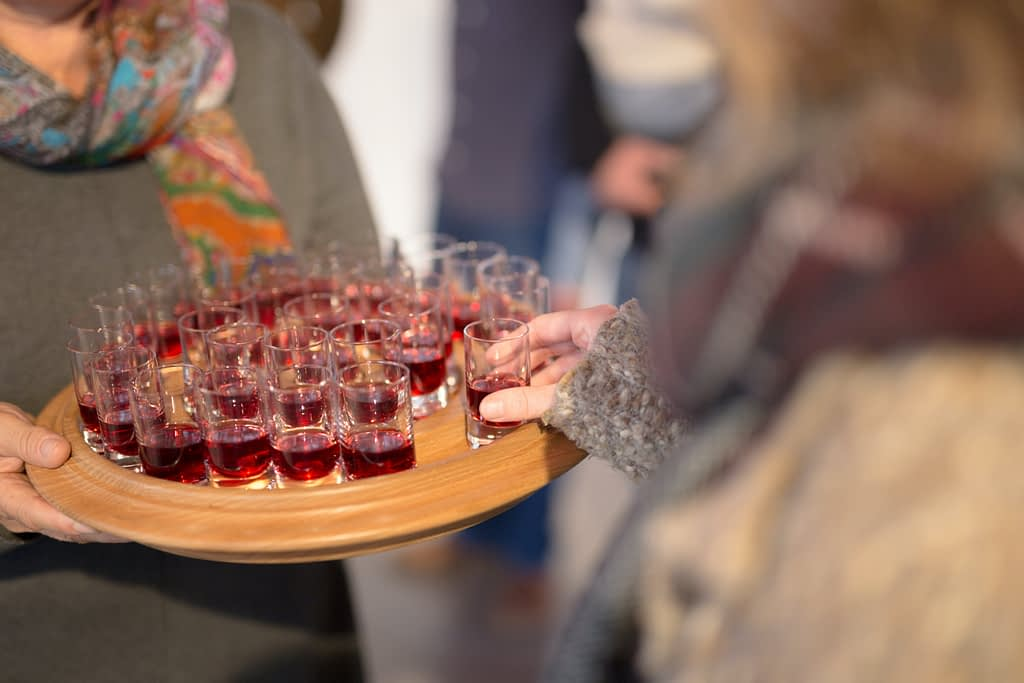 Illustration: Communion being given in individual glasses