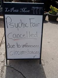 Sign: Psychic fair cancelled due to unforeseen circumstances
